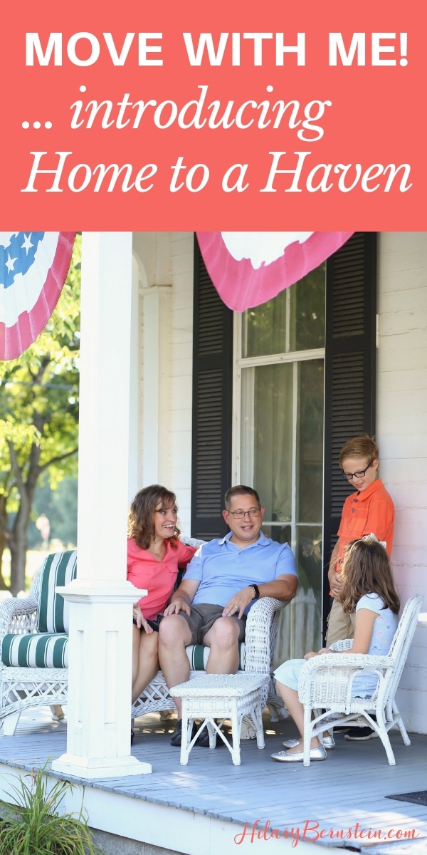 Family is smiling while sitting on a front porch together