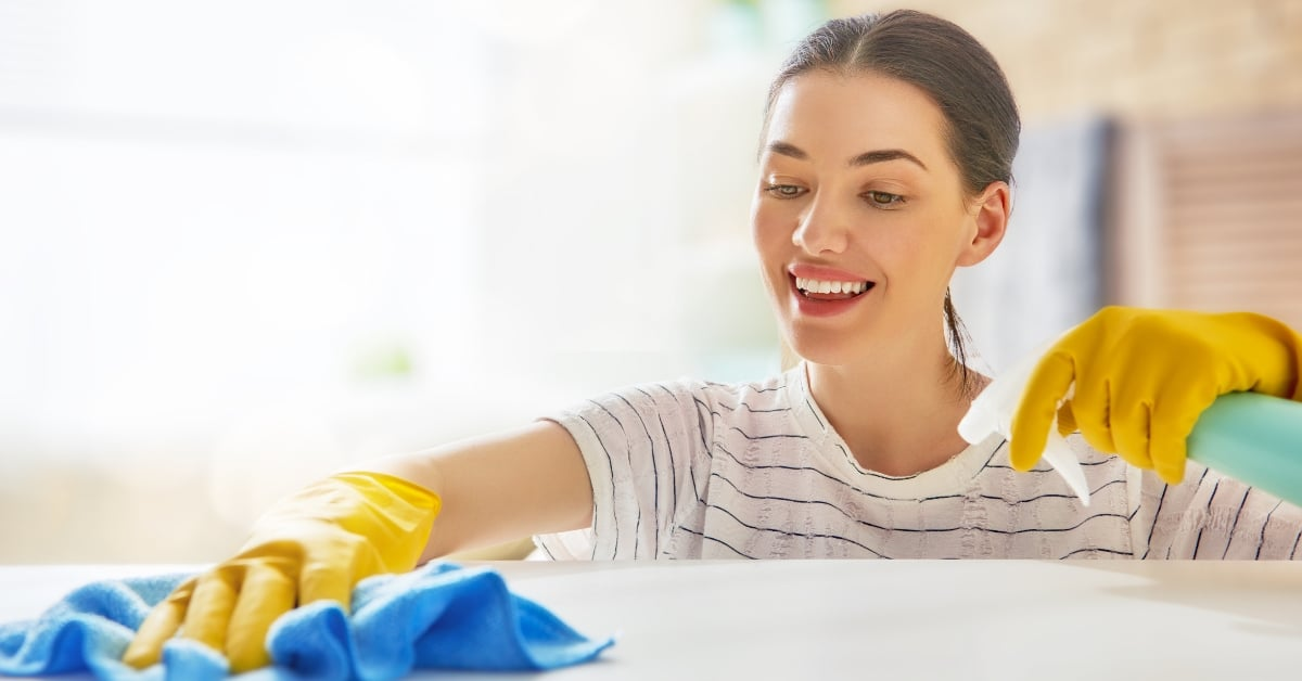 Woman wipes off a countertop
