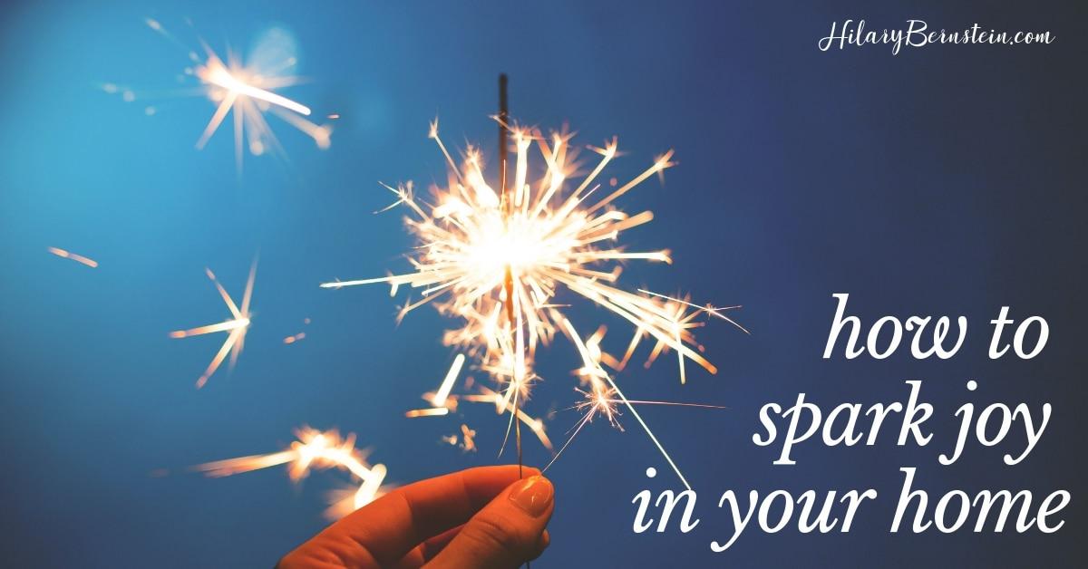 Hand holds a lit sparkler
