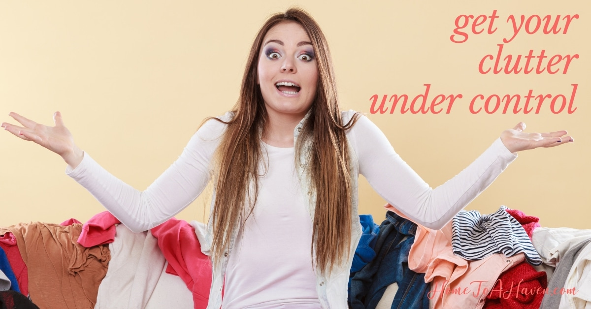 An exasperated woman is surrounded by clutter