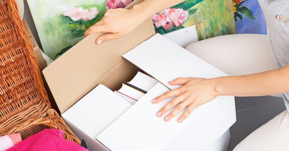 Woman packs moving box