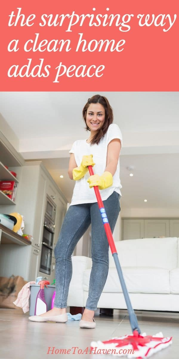 Woman smiles while she mops the floor