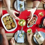 Family gathers around full dinner table