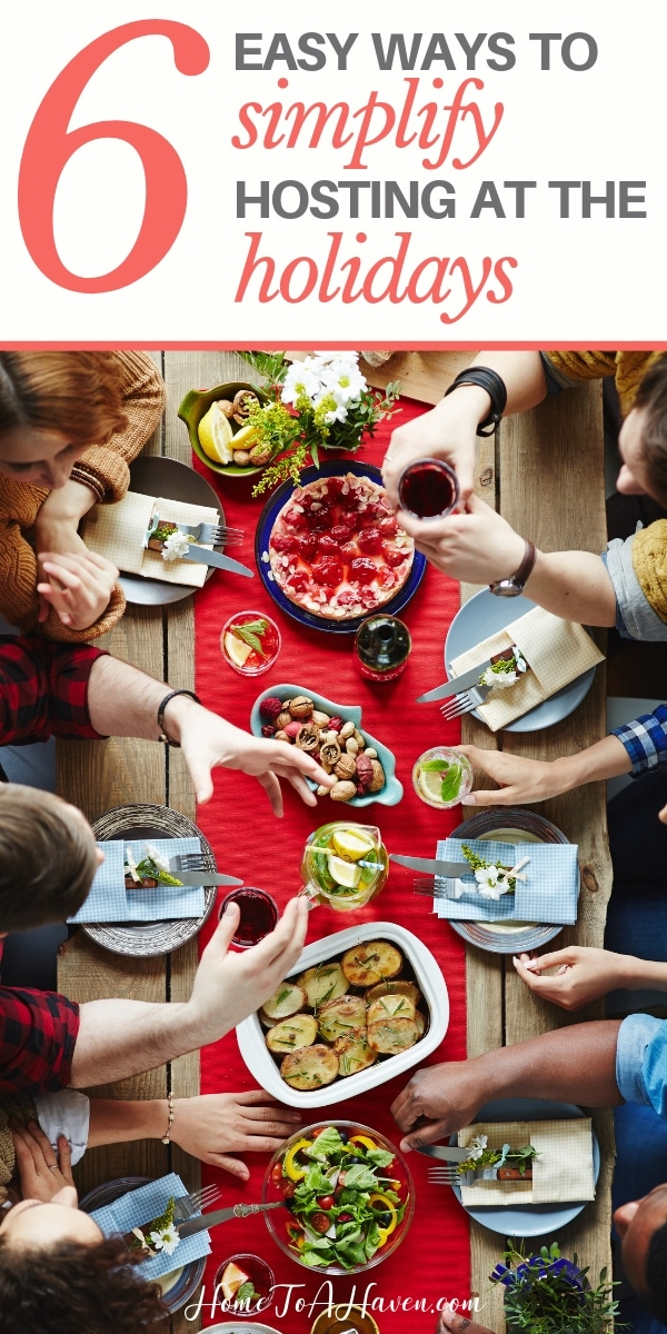 Family eats a meal at a dining room table