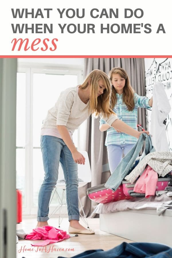 Two sisters clean a messy bedroom