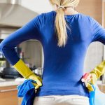 Woman stands in clean kitchen