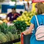 Woman shops for fresh produce