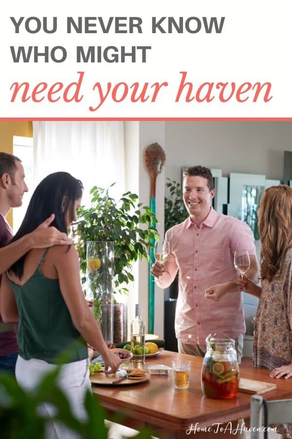 Friends gather around kitchen island