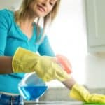 Woman washes countertop