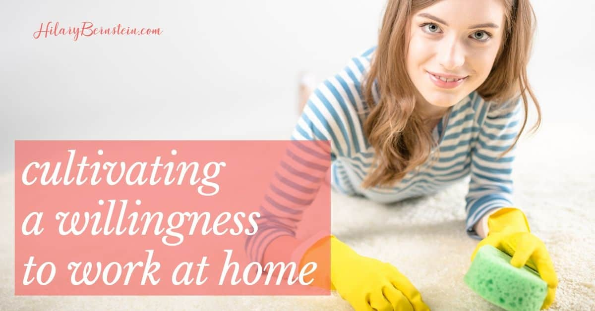 Woman smiles with cleaning sponge