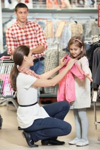 Mom and daughter shop for coats