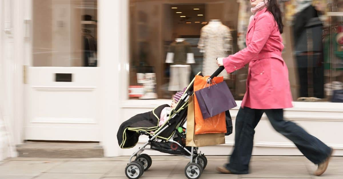 Mom shops while pushing stroller