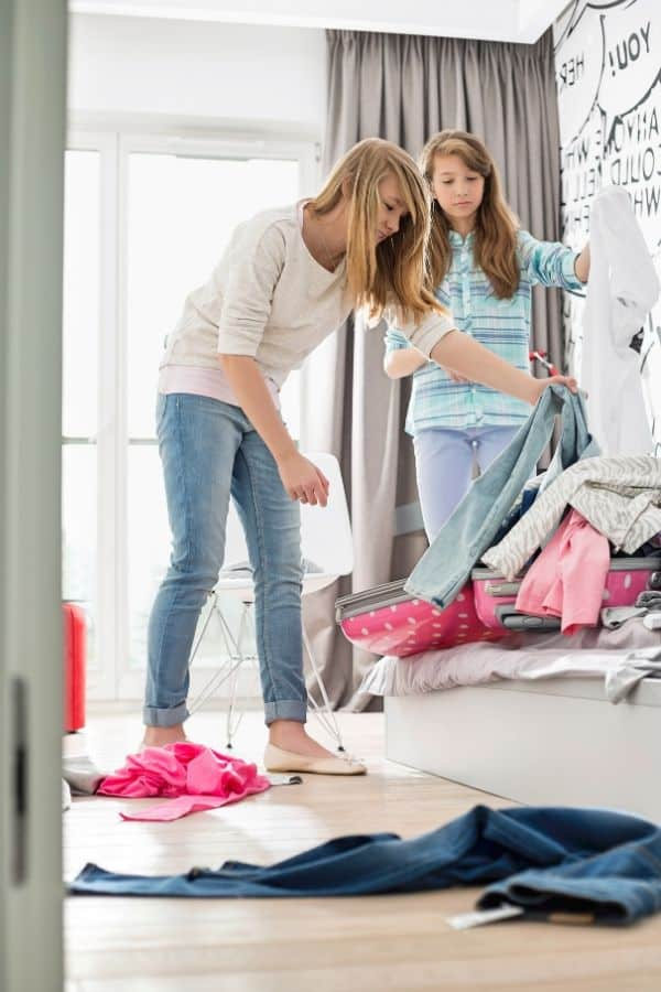 Mom and daughter sort through clothing
